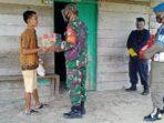 Satbrimob Aceh Bagikan Sembako Kepada Masyarakat Kurang Mampu
